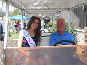 Chamber Event Coordinator, Tim Gann chauffeurs Miss Center Point, Jordan Dailey around the park.